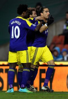 Swansea's Chico Flores, right, celebrates after scoring against Stoke City during the English Premier League soccer match between Stoke City and Swansea City at Britannia Stadium in Stoke On Trent, England, Wednesday, Feb. 12, 2014. (AP Photo/Rui Vieira)