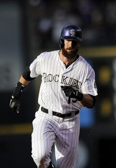 Colorado Rockies Charlie Blackmon rounds the bases after hitting a solo home run in the first inning of a baseball game against the Arizona Diamondbacks on Thursday, June 5, 2014, in Denver. (AP Photo/Chris Schneider)