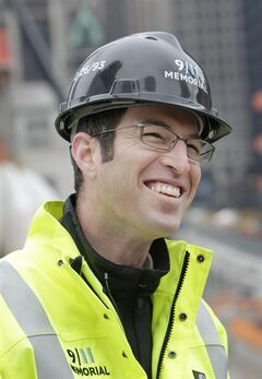 In this April 7, 2011 photo, Michael Arad, an architect of the 9/11 memorial at ground zero, speaks to a reporter in front of the ongoing construction at ground zero in New York. Arad first imagined the twin reflecting pools with cascading waterfalls — he calls them voids — as two empty spaces in the Hudson River west of the smoldering World Trade Center, to mirror the absent towers. The pools moved to the twin towers' footprints, and the Israeli-born architect 's poster board sketch became the centerpiece for the world's most expensive memorial — and a touchstone for post-Sept. 11 battles over how to mourn and how to remember. (AP Photo/Seth Wenig)