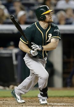 Oakland Athletics' Brandon Moss watches his fifth-inning solo home run off New York Yankees starting pitcher Hiroki Kuroda in a baseball game at Yankee Stadium in New York, Tuesday, June 3, 2014. (AP Photo/Kathy Willens)