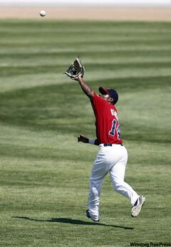 Winnipeg Goldeyes' Price Kendall reels in a pop-up during Winnipeg's 12-9 win over the Schaumburg Flyers Sunday.