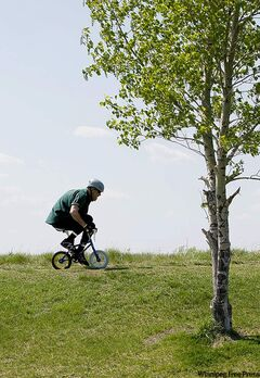 Kent Anthony rides his pixie bike Sunday afternoon on Garbage Hill.