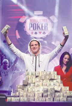 Pius Heinz, of Germany, celebrates winning the World Series of Poker 2011, in Las Vegas.