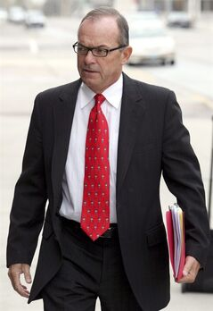 FILE - In this April 29, 2009, file photo, Tim Blixseth arrives at the federal courthouse in Missoula, Mont. The trustee representing Yellowstone Club creditors offered a reward Wednesday, Aug. 20, 2014, to anyone who can help uncover property or bank accounts that Blixseth, the luxury resort's co-founder, might have hidden from bankruptcy proceedings. (AP Photo/Mike Alban, File)