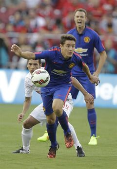 Manchester United's Angelo Henriquez, front, moves the ball as Inter Milan's Ruben Botta, center, defends during the first half of a soccer game at the 2014 Guinness International Champions Cup, Tuesday, July 29, 2014, in Landover, Md. (AP Photo/Luis M. Alvarez)