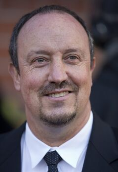 Chelsea manager Rafa Benitez smiles as he takes to the touchline before their English FA Cup quarterfinal soccer match against Manchester United at Old Trafford Stadium, Manchester, England, Sunday March 10, 2013. (AP Photo/Jon Super)