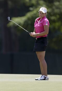 Brooke Mackenzie Henderson, of Canada, misses a putt on the 12th hole during the first round of the U.S. Women's Open golf tournament in Pinehurst, N.C., Thursday, June 19, 2014. (AP Photo/Bob Leverone)