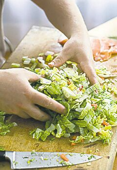 Chef Jamie Oliver prepares his posh chopped salad.