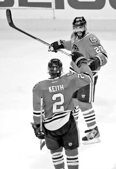 Chicago defenceman Johnny Oduya celebrates his game-tying goal in the third period with fellow D-man Duncan Keith.
