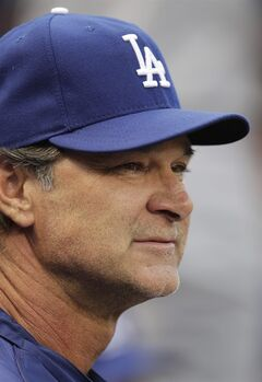 Los Angeles Dodgers manager Don Mattingly watches the action from the bench in the first inning of a baseball game against the St. Louis Cardinals, Sunday, July 20, 2014, in St. Louis. (AP Photo/Tom Gannam)