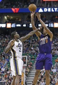 Phoenix Suns' Channing Frye (8) shoots as Utah Jazz's Marvin Williams (2) defends in the second quarter of an NBA basketball game on Wednesday, Feb. 26, 2014, in Salt Lake City. (AP Photo/Rick Bowmer)