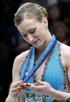 Joannie Rochette admires her medal during presentation ceremonies Thursday.