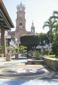 Chalk murals lining the town square near Puerto Vallarta's famous cathedral provide a punch of colour.