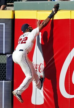 Atlanta Braves right fielder Jason Heyward (22) makes a catch at the wall in the eighth inning of a baseball game in Atlanta, Saturday, July 5, 2014. (AP Photo/John Bazemore)