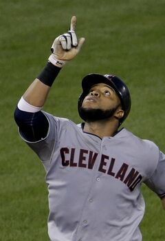 Cleveland Indians' Carlos Santana celebrates as he crosses the plate after hitting a two-run home run during the sixth inning of a baseball game against the Kansas City Royals, Friday, July 25, 2014, in Kansas City, Mo. (AP Photo/Charlie Riedel)