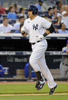New York Yankees' Carlos Beltran rounds the bases with a home run during the third inning of a baseball game against the Toronto Blue Jays on Friday, July 25, 2014, at Yankee Stadium in New York. (AP Photo/Bill Kostroun)