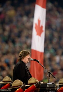 Burton Cummings performs the national anthem at the start of the 100th Grey Cup on Sunday.