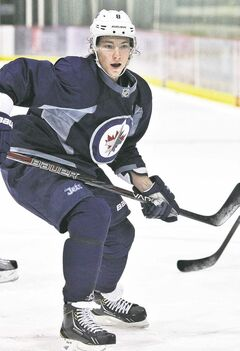 Jets centre Alex Burmistrov, skating at the MTS Iceplex Thursday, will be playing somewhere this season.
