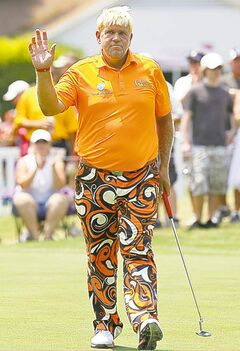 John Daly acknowledges the crowd after a birdie on the number nine green at the Crowne Plaza Invitational at Colonial in Fort Worth, Texas, Friday, May 25, 2012. (Ron T. Ennis/Fort Worth Star-Telegram/MCT)
