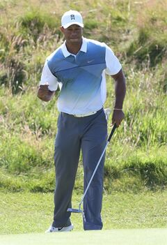 Tiger Woods of the US celebrates after a birdie on the 11th hole during the first day of the British Open Golf championship at the Royal Liverpool golf club, Hoylake, England, Thursday July 17, 2014. (AP Photo/Peter Morrison)