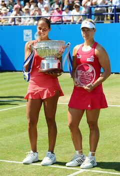 Madison Keys of the U.S, left, poses with the Women's Singles trophy after winning against Germany's Angelique Kerber during the AEGON International at Devonshire Park, Eastbourne, England, Saturday, June 21, 2014. (AP Photo/Clive Gee, PA Wire) UNITED KINGDOM OUT - NO SALES - NO ARCHIVES