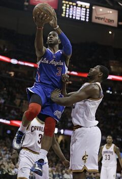 Los Angeles Clippers' Chris Paul (3) jumps to the basket against Cleveland Cavaliers' Tristan Thompson during the first quarter of an NBA basketball game on Friday, March 1, 2013, in Cleveland. (AP Photo/Tony Dejak)