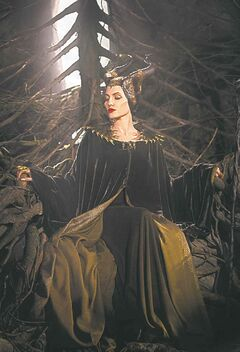 Jolie as Maleficent in an opulent gown.