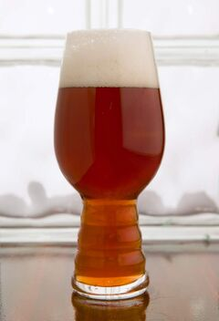 A glass made especially to drink India pale ales helps enhance the aromas.