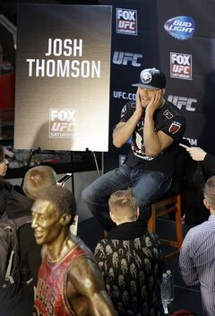 Mixed martial Arts fighter Josh Thomson, top right, talks with reporters during a media availability at the United Center for his upcoming UFC fight, Thursday, Jan. 23, 2014, in Chicago. Thomson will face off against Benson Henderson on Saturday, Jan. 25, 2014. (AP Photo/Nam Y. Huh)