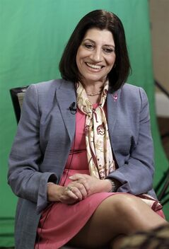 Judy Salerno smiles during an interview in Fort Worth, Texas, Friday, July 18, 2014. Salerno, a physician with a long career in health policy and research, was named the new president and CEO of Susan G. Komen for the Cure last June. (AP Photo/LM Otero)