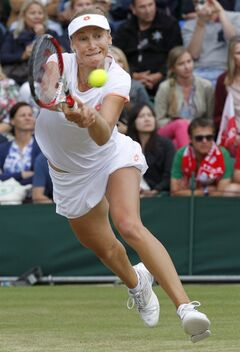 Ekaterina Makarova of Russia plays a return to Agnieszka Radwanska of Poland during their women's singles match at the All England Lawn Tennis Championships in Wimbledon, London, Monday, June 30, 2014. (AP Photo/Sang Tan)