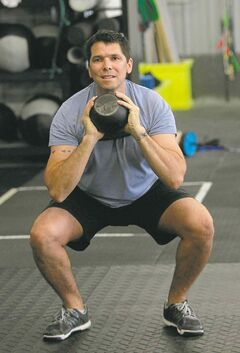 James Wilson in class during warm up exercises while training at CrossFit Winnipeg.