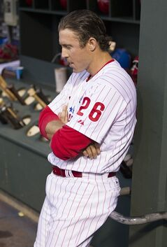 Philadelphia Phillies' Chase Utley leans agains the dugout after popping out during the fourth inning of a baseball game against the New York Mets, Monday, June 2, 2014, in Philadelphia. (AP Photo/Chris Szagola)