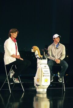 Current World Number One golf champion Rory McIlroy, right, and Nike Golf President Cindy Davis attend a press conference announcing McIlroy's partnership with Nike ahead of the 2013 edition of the Abu Dhabi HSBC Golf championship in Abu Dhabi, United Arab Emirates, on Monday, Jan. 14, 2013. (AP Photo/Manuel Salazar)