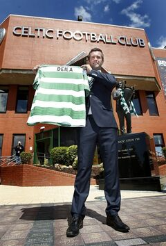 Ronny Deila is unveiled as the new Celtic manager during a photo call at Celtic Park, Glasgow, Friday, June 6, 2014. Norwegian coach Ronny Deila has been hired as the new manger of Scottish champion Celtic. The 38-year-old Deila joins the Glasgow club on a 12-month rolling contract from Norwegian side Stromsgodset. He guided the club to its first Norwegian league title in 43 years last season. Deila takes over at Celtic from Neil Lennon, who quit last month after winning five trophies in four years. (AP Photo/Danny Lawson, PA Wire) UNITED KINGDOM OUT - NO SALES - NO ARCHIVES
