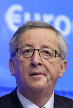 FILE - In this Dec. 13, 2012 file photo, Luxembourg's Prime Minister Jean-Claude Juncker pauses before speaking during a media conference after a meeting of eurogroup finance ministers in Brussels. The incoming leader of Europe's most powerful bureaucracy is a master of the backroom deal, and an outspoken and witty career politician who once advocated the right to lie in times of crisis. Juncker, who was prime minister of Luxembourg for almost two decades, was a controversial pick as the 28-nation European Union's new chief executive, not least because the British government vociferously opposed him. (AP Photo/Virginia Mayo, file)