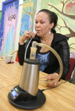 Medical marijuana user Lee-Anne Kent smokes at the lounge.