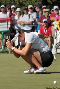 LPGA player Michelle Wie reacts to missing a birdie putt in Winnipeg during the CN Can­adian Women's Open.