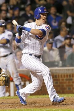 Chicago Cubs' Chris Coghlan watches his RBI double off Milwaukee Brewers starting pitcher Yovani Gallardo, scoring Justin Ruggiano, during the fifth inning of a baseball game Monday, Aug. 11, 2014, in Chicago. (AP Photo/Charles Rex Arbogast)