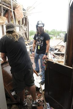 In this photo taken on Monday, June 23, 2014, rock star Bret Michaels looks over the art room at the middle school in Pilger, Neb., destroyed in last week's tornado. Michaels and his band and crew stopped in Pilger on Monday to see the devastation and do some volunteer cleanup work. (AP Photo/The Norfolk Daily News, Darin Epperly)