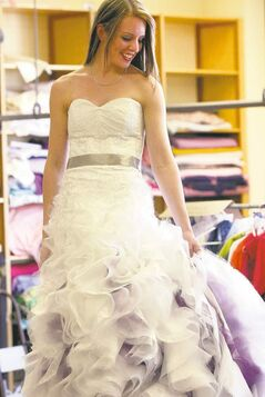 Adult student Anna Laudin with her wedding dress.