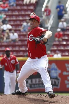 Cincinnati Reds starting pitcher Dylan Axelrod throws against the Chicago Cubs in the first inning of a baseball game, Thursday, Aug. 28, 2014, in Cincinnati. (AP Photo/David Kohl)