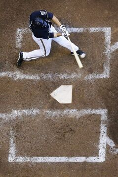 Milwaukee Brewers' Mark Reynolds hits a two-run home run during the sixth inning of a baseball game against the Cincinnati Reds Wednesday, July 23, 2014, in Milwaukee. (AP Photo/Morry Gash)