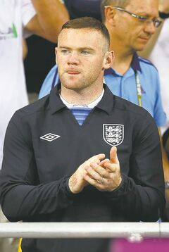 Wayne Rooney spectates at Friday's Group D match between Sweden and England in Kyiv.