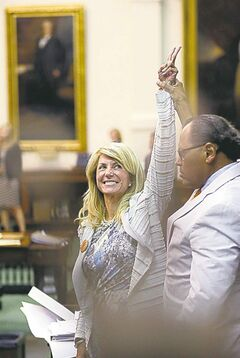 Sen. Wendy Davis waves to supporters shortly after midnight in Texas Tuesday.