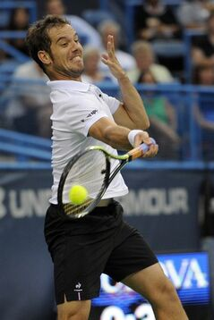 Richard Gasquet, of France, returns a shot against Kei Nishikori, of Japan, during a match at the Citi Open tennis tournament, Friday, Aug. 1, 2014, in Washington. Gasquet won 6-1, 6-4. (AP Photo/Nick Wass)