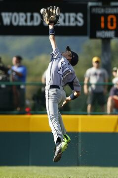 Australia's Blake Monaghan cannot reach a hit by Puerto Rico's Edward Gonz�lez during the first inning of an international pool play baseball game at the Little League World Series, Thursday, Aug. 14, 2014, in South Williamsport, Pa. Puerto Rico won 16-3. (AP Photo/Matt Slocum)