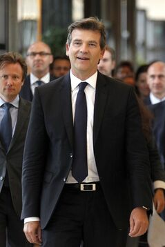 Economy Minister Arnaud Montebourg arrives for a press conference in Paris, Monday, Aug.25, 2014. France's Socialist government dissolved on Monday after open feuding in the Cabinet over how much cutting _ or spending _ will revive the country's stagnant economy. The country is under pressure from the 28-nation European Union to get its finances in order, but Economy Minister Arnaud Montebourg has questioned whether austerity will really kick start French growth. (AP Photo/Christophe Ena)