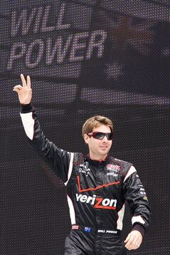 FILE - In this June 19, 2011, file photo, Will Power waves to the crowd before the IndyCar Series' Milwaukee Mile 225 auto race at the Milwaukee Mile in West Allis, Wis. Power heads into Milwaukee with a chance to solidify his championship hopes and erase the memories of bittersweet runner-up finishes in 2011 and 2012. (AP Photo/West Bend Daily News, John Ehlke, File)