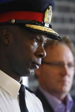 Police Chief Devon Clunis and Coun. Scott Fielding at a news conference Tuesday.